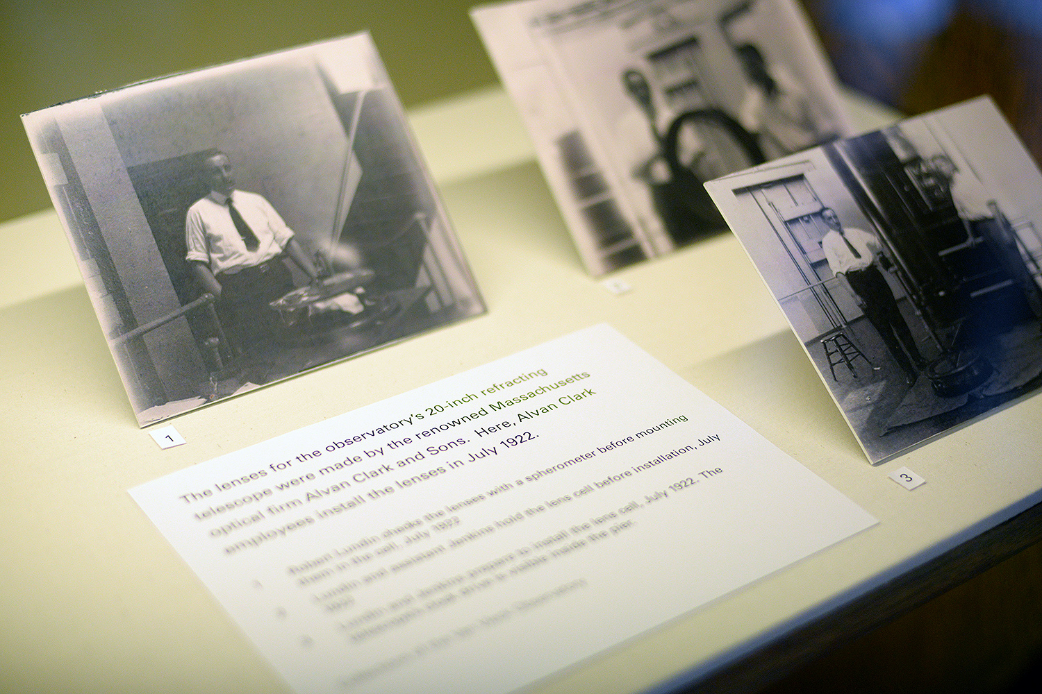 Photographs on display in the exhibit included shots of employees of the renowned optical firm Alvan Clark and Sons installing lenses on the observatory's 20-inch refracting telescope in July 1922.