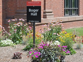 A newly-planted flower bed adds a burst of color to the exterior of Boger Hall.