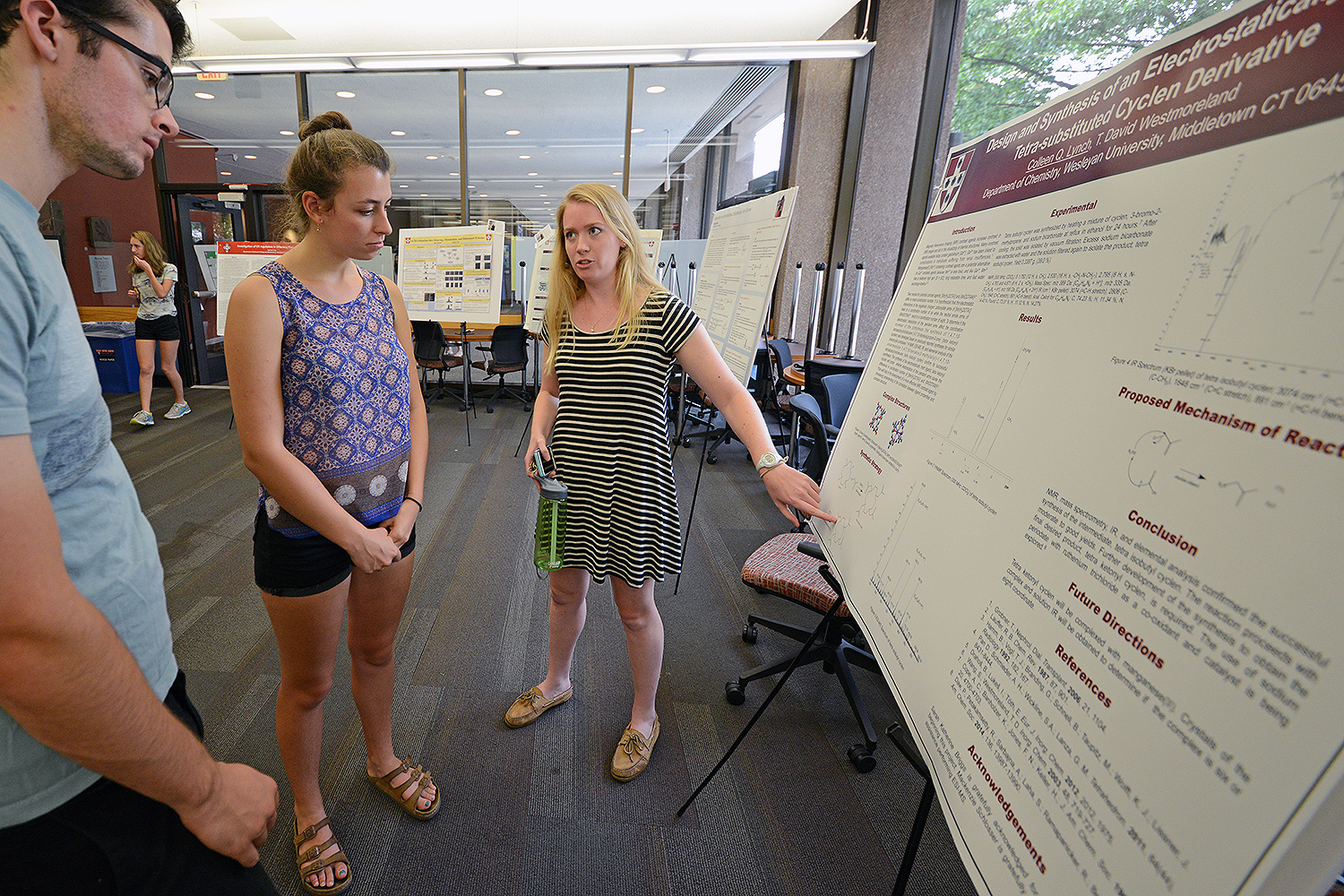 "Colleen Lynch '19 speaks to her peers about her study titled ""Design and Synthesis of an Electrostatically Neutral Tetra-substituted Cyclen Derivative."" Her advisor is T. David Westmoreland, associate professor of chemistry, associate professor of integrative sciences."