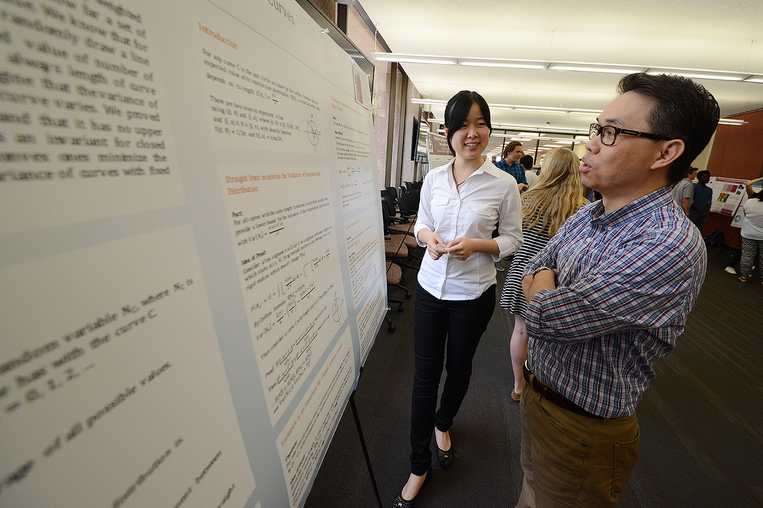 "Fanying Chen '18 speaks to Billy Chan, professor of mathematics about her study titled ""Geometry and Intersection Distribution for Curves."" Chen's advisor is David Constantine, assistant professor of mathematics."