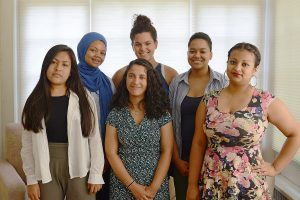 From left, Delia Tapia '18, Alicia Strong '18, Aura Ochoa '17 (front), Iryelis Lopez '17 (back), Paige Hutton '18 and Aleyda Robles '18 spent six weeks this summer developing research topics as part of the Mellon Mays Undergraduate Fellowship Program. They presented their ideas on July 28, 2016 at the Center for African Studies.
