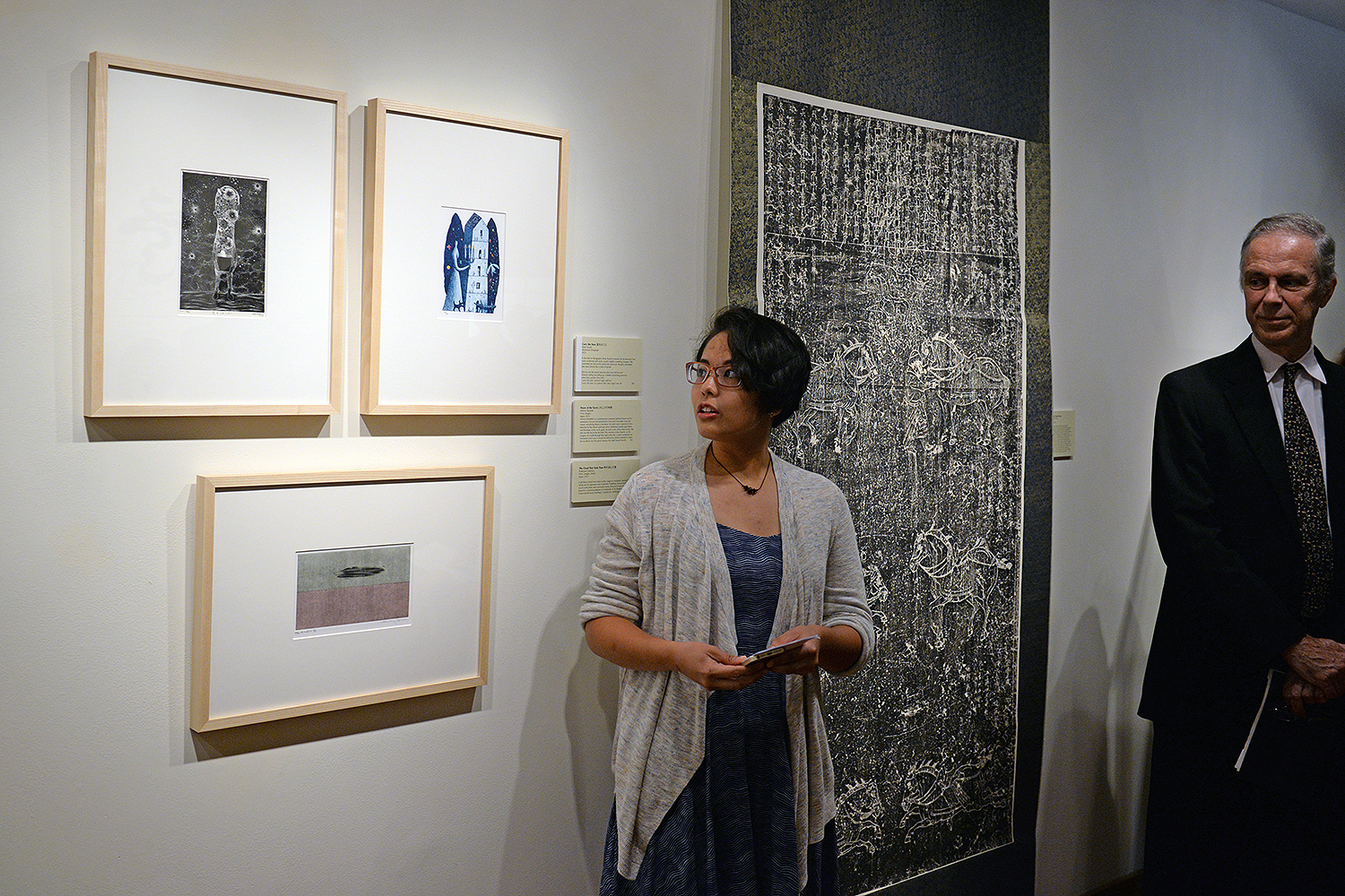 "Erin Deleon '17 speaks about an aluminum lithograph titled ""Carry the Stars (2013)."" The artist, Ryoji Suzuki, is known for his beautiful line work combined with stark, unsettling imagery."