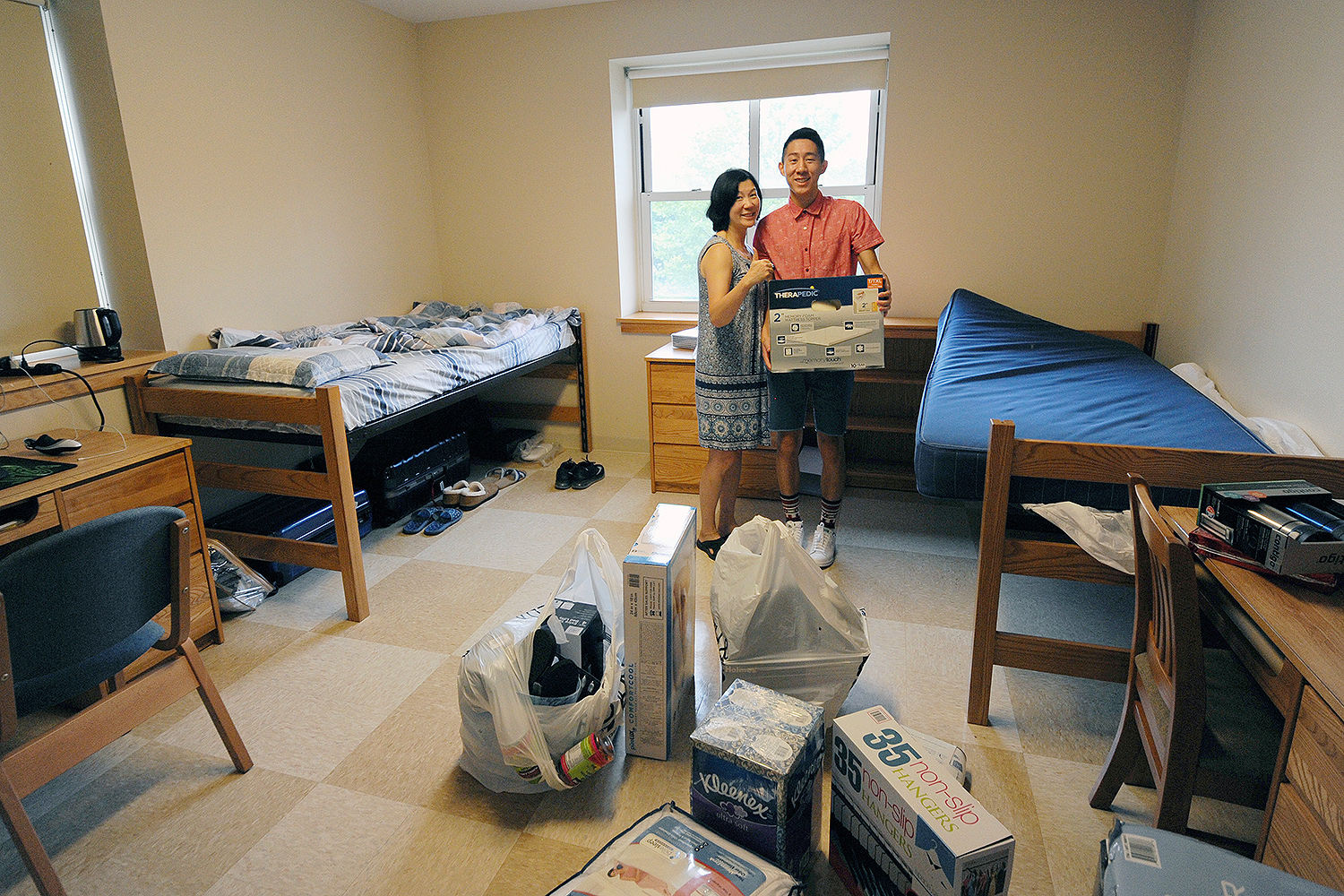 "William Wu '20, from Sammamish, Wash. and his mother, Celia, spent the morning unpacking and decorating William's new room in Bennet Hall. ""I really like campus and the general atmosphere,"" William said. He's considering a major in philosophy."
