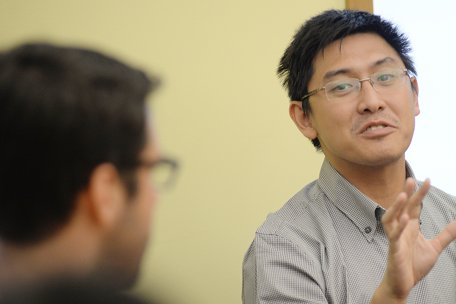 """Ying Jia Tan, assistant professor of history, attended the discussionto learn about the concerns of Asian-American students. He spoke about his experience as faculty advisor to the Asian Students Association at his previous institution anddrew parallels between the racial categorization in his home country ofSingapore and the United States. The term """"Asian American"""" was analogous to the """"others"""" category in Singapore."""