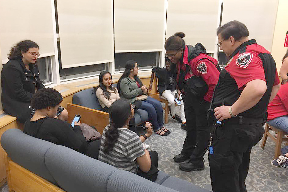 Officers Maggie Taylor and Ray Czaja mingle with students.