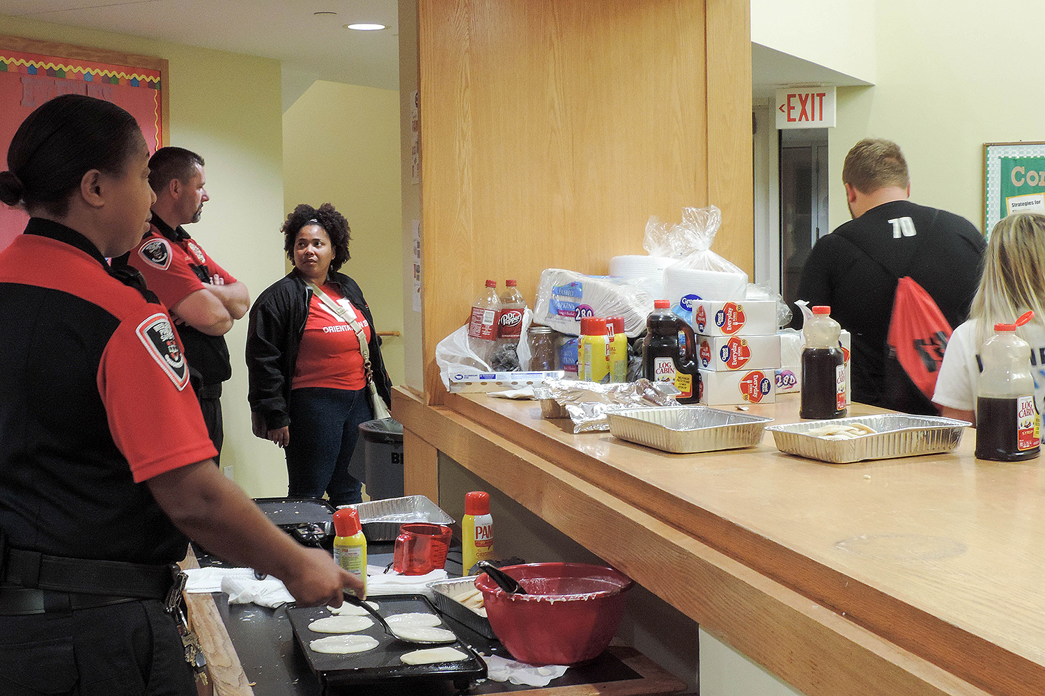 Second-shift Public Safety Officers cook pancakes in Bennet Hall.