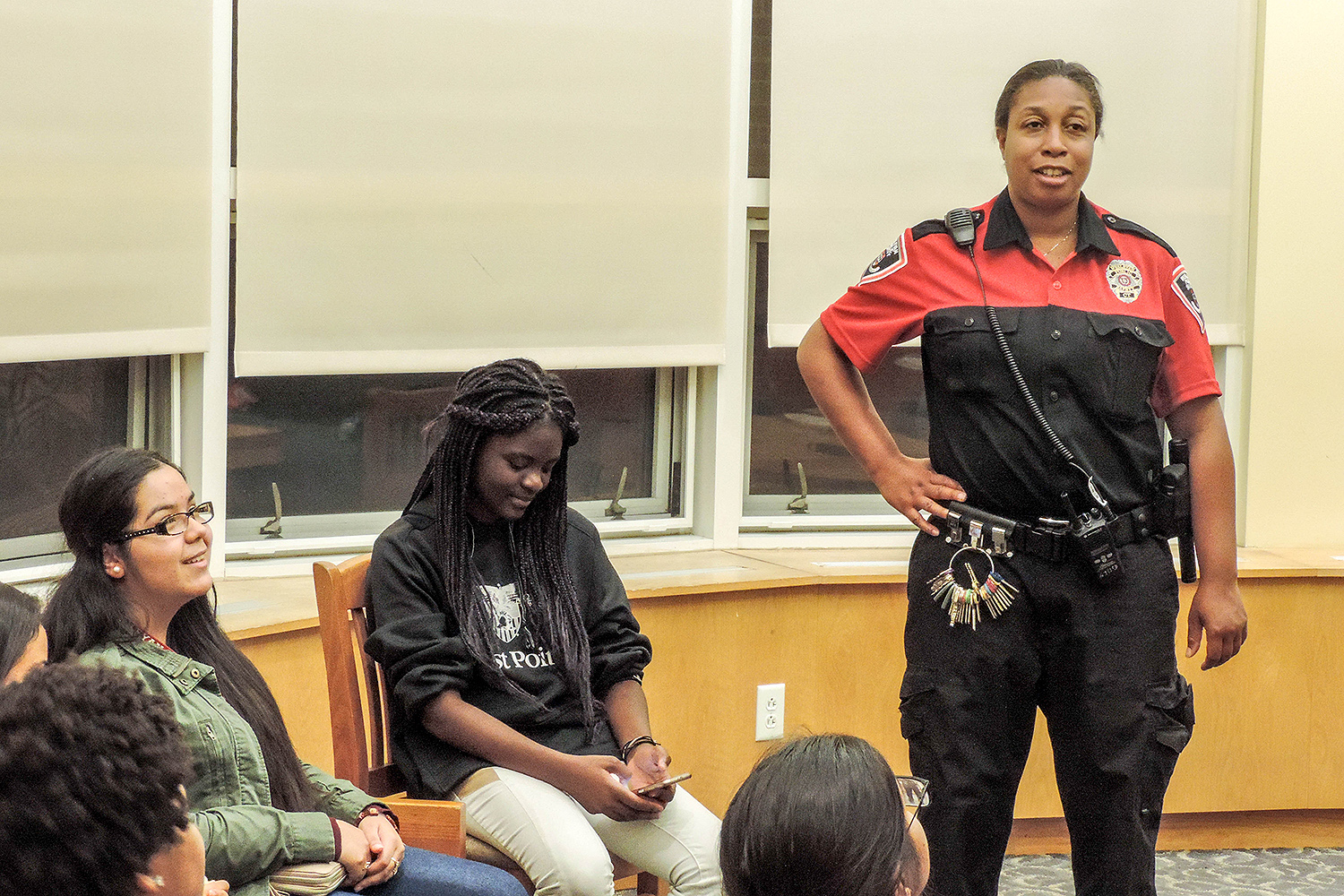 "Public Safety Supervisor Lt. Sharon Mclaurin speaks to students in Bennet Hall during ""Pancakes with P-Safe"" Sept. 24."