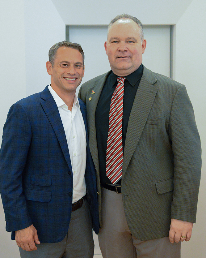 Jed Hoyer '96, Chicago Cubs Executive Vice President/General Manager with Director of Athletics Mike Whalen '83 at the 2016 Athletics Hall of Fame dinner at Wesleyan during Homecoming Weekend.