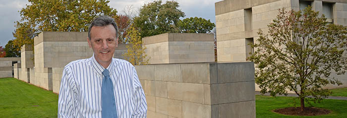 Professor Joe Siry stands outside in the Center for the Arts Complex on Oct. 17.