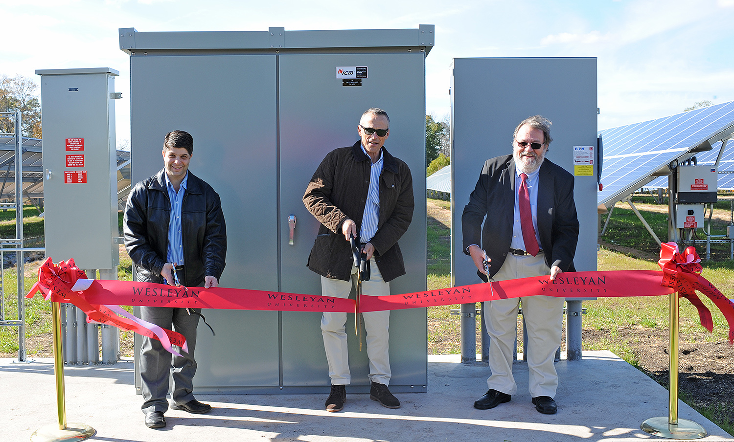 City of Middletown Mayor Daniel Drew, Wesleyan President Michael Roth, and former Vice President for Finance and Administration John Meerts participated in a ribbon-cutting ceremony Nov. 1 for Wesleyan's new photo