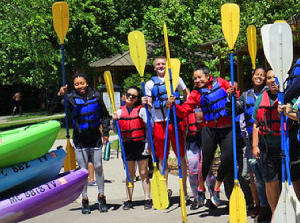 Kelly Lam, pictured second from left, joins fellow Doris Duke Conservation Scholars for a paddle in Michigan.