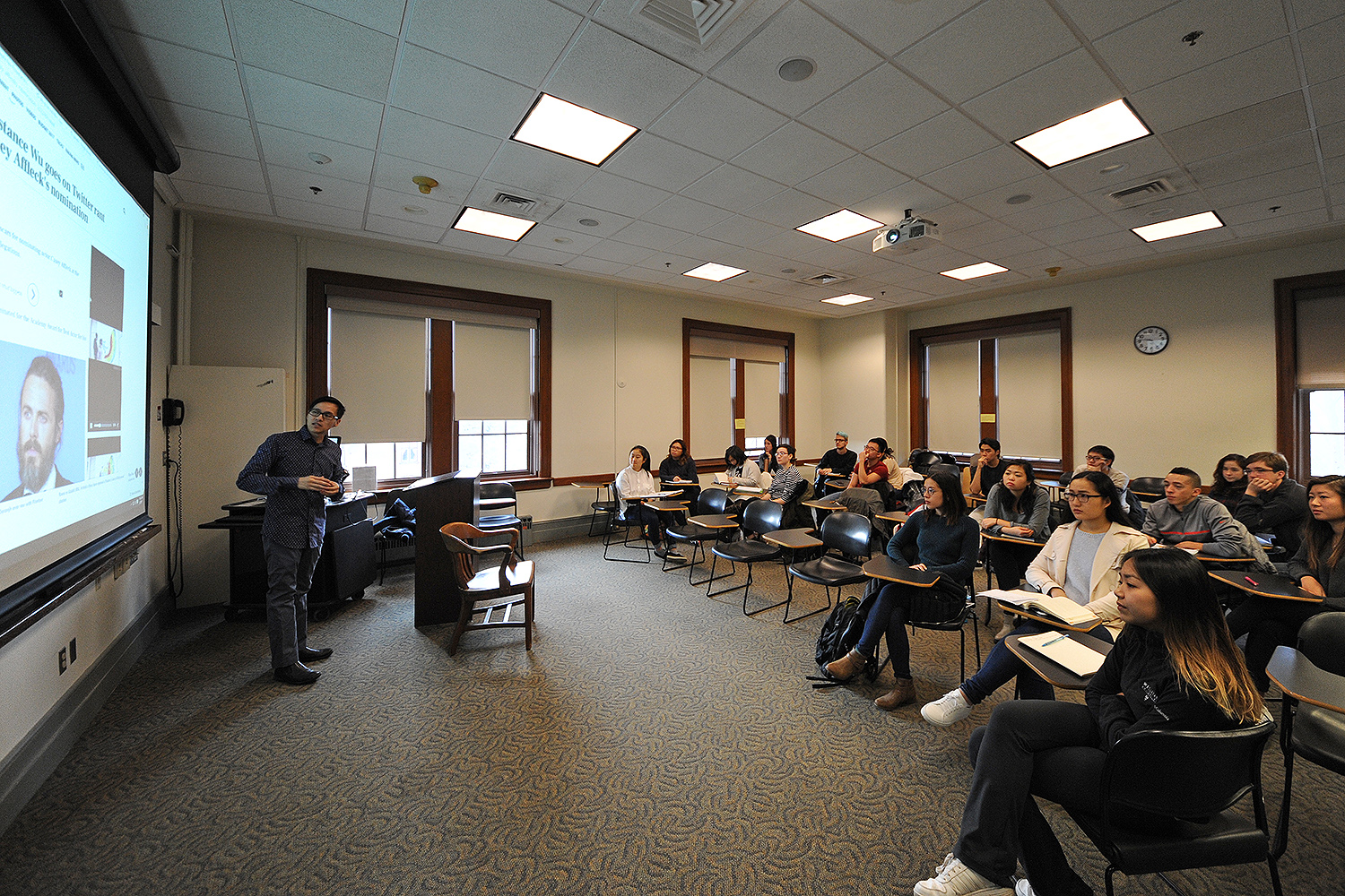 Long Bui, visiting assistant professor of American studies, teaches his AMST 220 Asian Americans and Pop Culture class on Jan. 27 in Fisk Hall, the first class of the Spring Semester. Throughout the semester, students will explore the history and experiences of Asian Americans through the site of popular culture, which includes films, comics, television, music and digital culture.