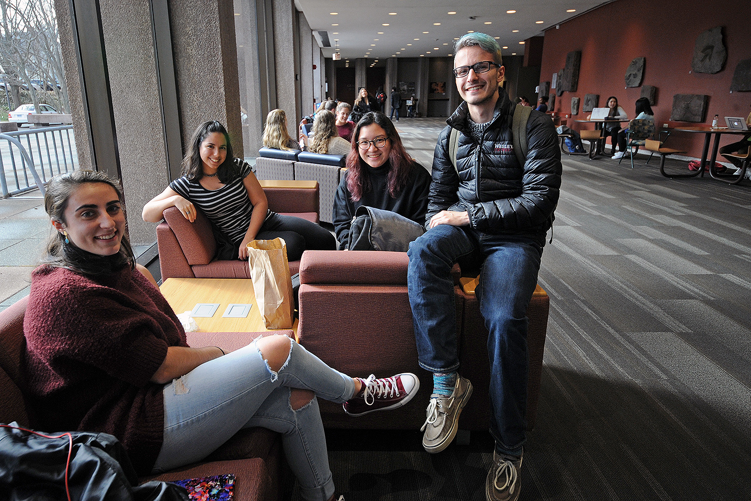 "Classmates Ali Friend '19, Teresa Naval '19, Alexis Jimenee '19 and Daniel Shaheen '19 gathered in Exley Science Center over lunch. Ali, who visited family in Toronto, Canada over Winter Recess, says she missed the Wesleyan squirrels. ""In Canada, the squirrels are black and twice as big as the gray squirrels. They are friendly, too, but not nearly as cute as Wes Squirrels,"" she said."