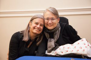 "Christina Crosby, right, pictured with her partner Janet Jakobsen at a March 2015 event at Barnard College focused on Crosby's memoir, ""A Body Undone: Living On After Great Pain."""