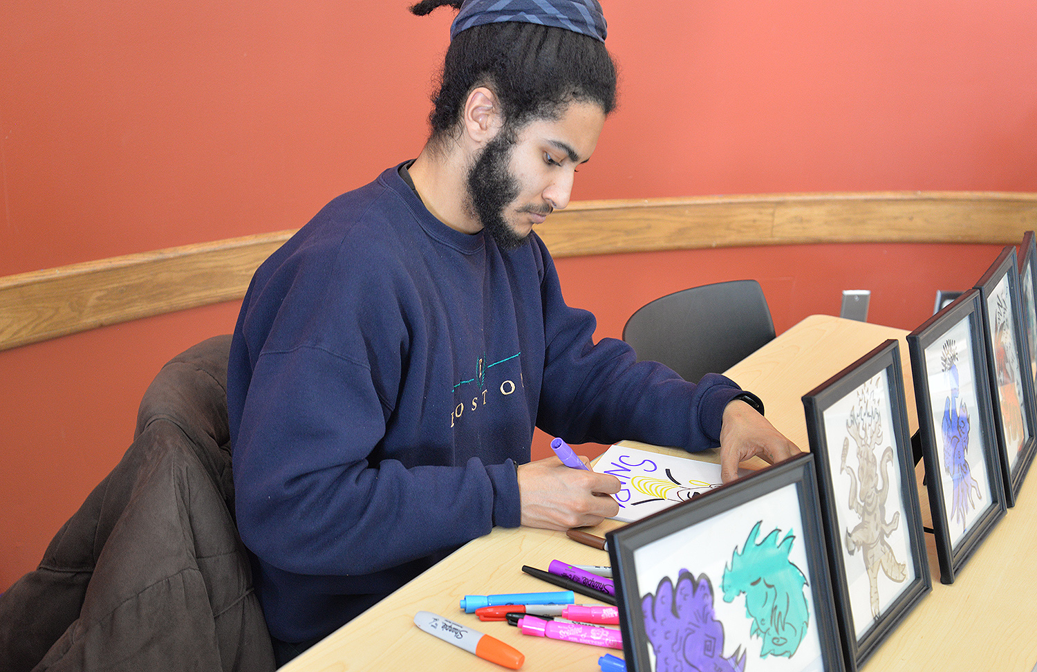 Jonah Toussaint '17 created custom artwork during Black Business Day held Feb. 16 in Usdan University Center. Toussaint and fellow students and local black vendors sold their products over the lunch hour.