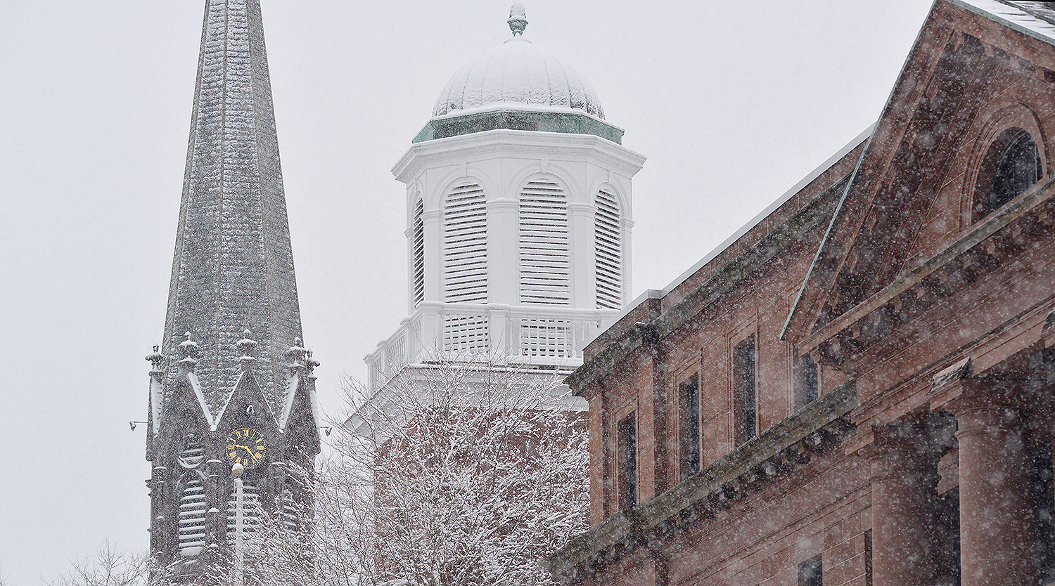 Snowy rooftops. From left, Memorial Chapel, South College, North College.
