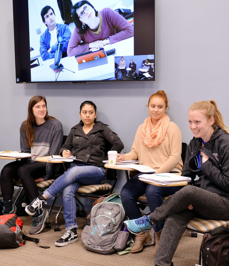 Wesleyan students hold conversations with students in Madrid from the Fisk 101 classroom.