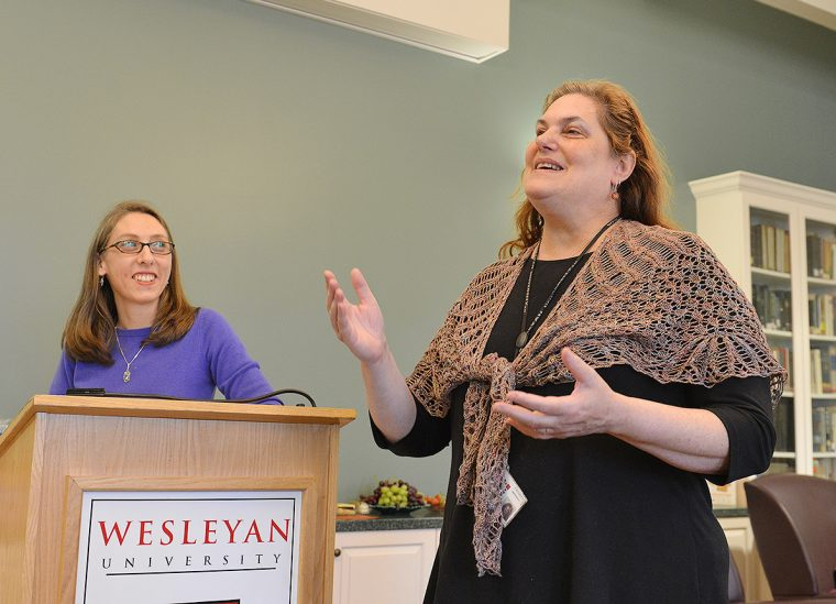 At right, Melissa Katz, visiting assistant professor of romance languages and literatures, speaks about the book she chose for essay winner Daniel Atik '20. Several faculty attended the essay content award ceremony to applaud and speak about their students' essays.