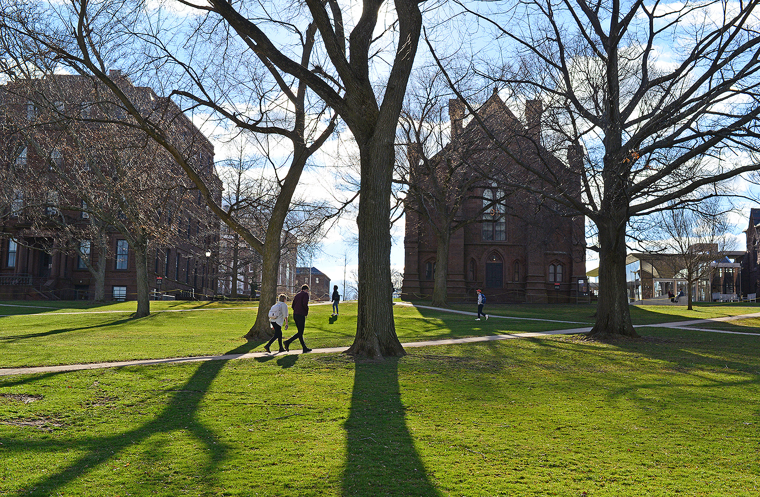 The sun casts long shadows on College Row, April 5.
