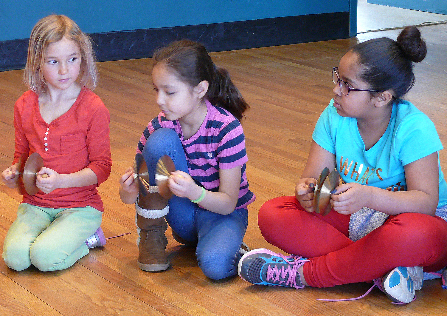 For many of the students, it was their first introduction to music theory and the complex layers of participation involved in creating an ensemble. The children began by learning about basic note values, such as the difference between a whole note and a half note, then moved into practicing rhythmic pattern exchanges, and ended by performing together as a percussion band.