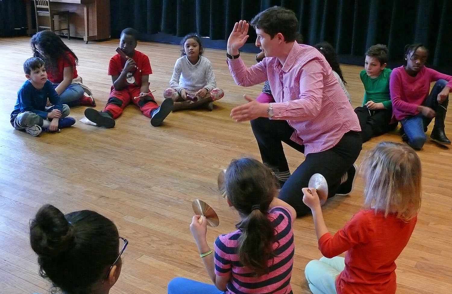Nadya Potemkina, adjunct assistant professor of music, led a musical lesson for students of Green Street's After School program onApril 4.