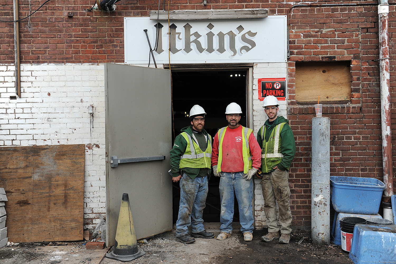 Contractors gather near the old Itkin building's rear door on Feb. 22.