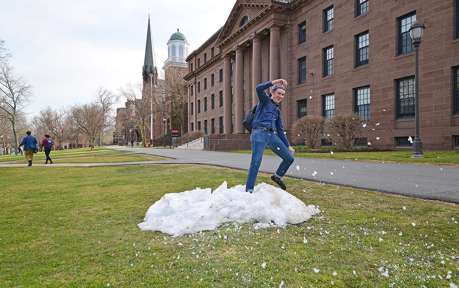 Will Barr '18 frolics in Wesleyan's last patch of snow April 3 on College Row. Will, who hails from Florida, is majoring in molecular biology and biochemistry and the College of Integrative Sciences. Temperatures reached 63 degrees.