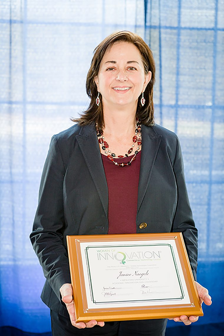 Jan Naegele accepts her Women of Innovation® award.