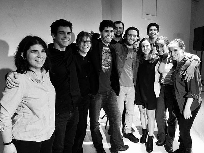 "When asked for a photo that includes Gabriel Urbina, the creator of Wolf 359 admits, ""There aren't many with me and Sarah, as usually we're the picture-takers during rehearsals and recordings! This snap of the full cast and crew of our first live show is probably the best one to get us is. Sarah is left-most, and I'm fourth going from left to right. """
