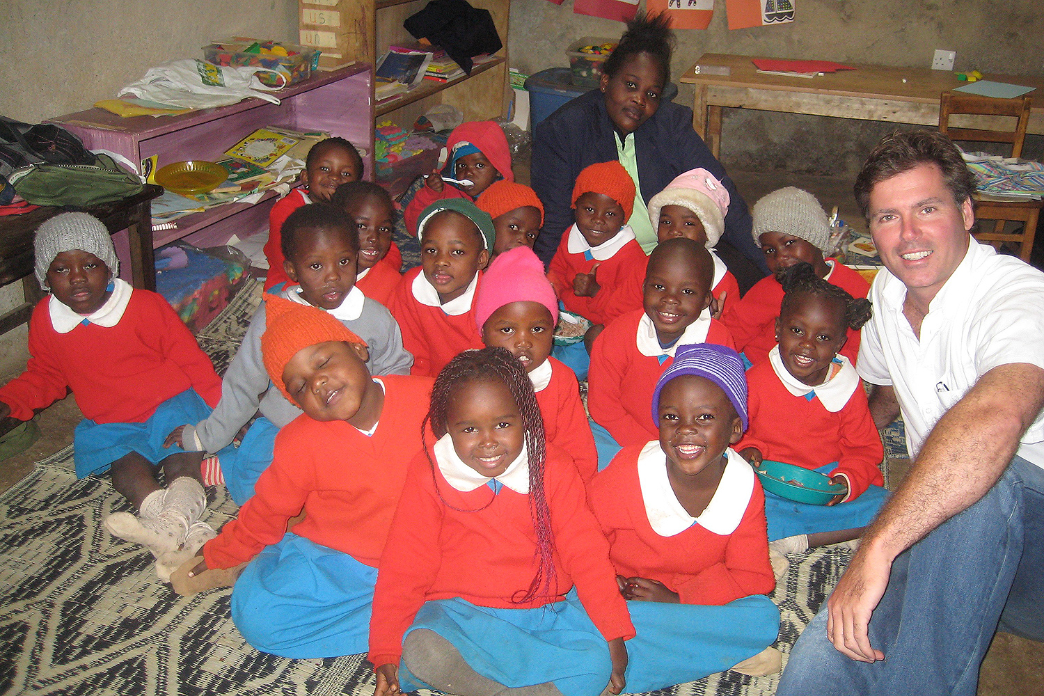 Professor Michael McAlear gathers with students at Shining Hope for Community, the nonprofit begun by Jessica '09 and Kennedy '12 Odede in Kibera, Africa.