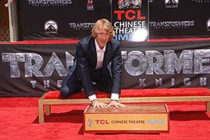Director Michael Bay '86 adds his prints to those of Hollywood icons outside TCL Chinese Theatre.