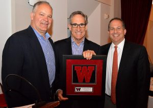 Mike Whalen and Dan Lynch present Alan Dachs, center, with the Athletic Advisory Council Award.