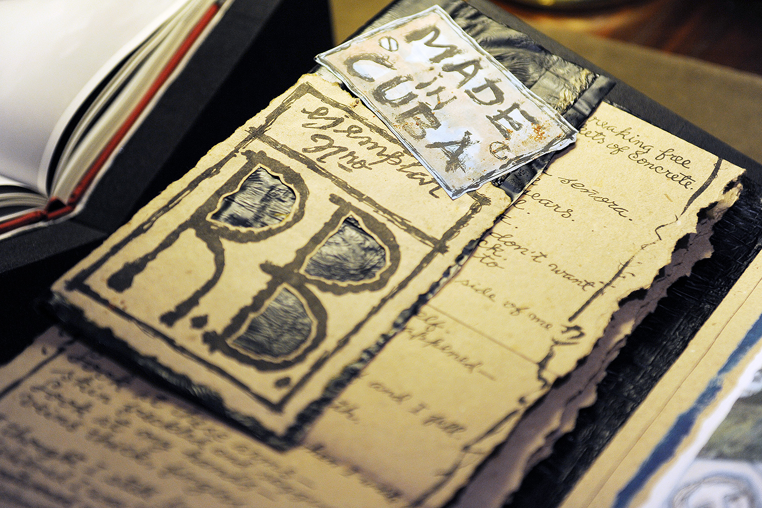 "The artist's book Las Calles Rotas De Mi Ciudad: Broken Streets of My City speaks to the ""brokenness"" of a nation and how this subjects the artist to a complicated identity with what she knows as Cuba and her Cubanidad. Her personal written poem describes longing for the country she once knew and can no longer be recovered."