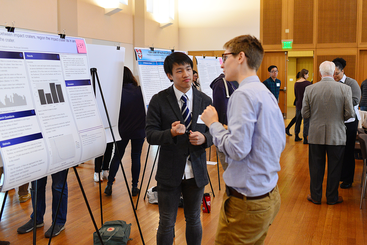 "Zehua (Jack) Wang '20 presented his story on ""The Relation between Region and Diameter of Impact Craters on Mars."""