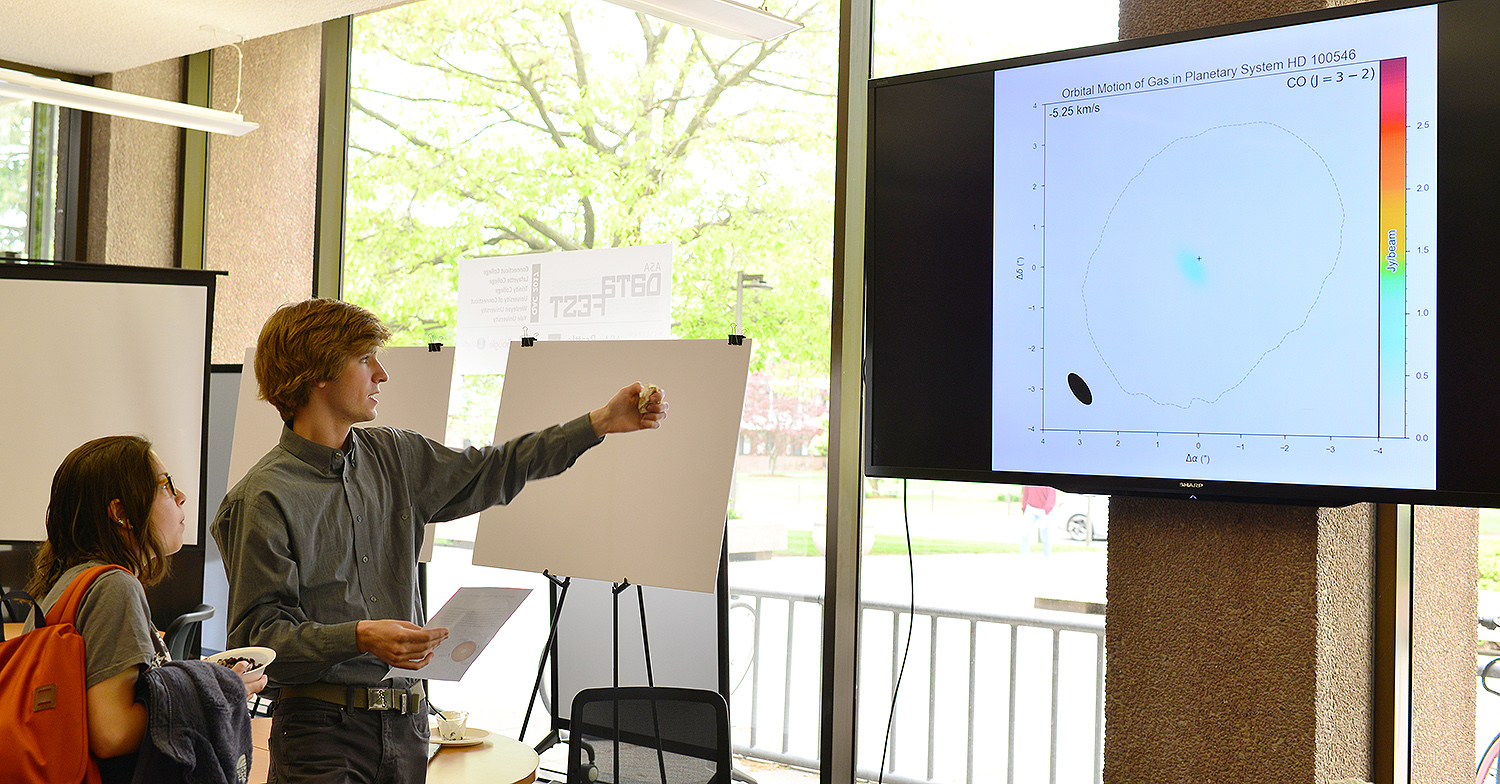 "On May 12, Wesleyan held its first student exhibition to showcase examples of visual knowledge and data visualization from across the campus. To be included, students needed to showcase how they conveyed or established information in a mainly non-verbal form. Cail Daley '18 presented his project titled ""Orbital Motion of Gas in Planetary System HD 100546."" He presented an animation that shows the orbital velocity of matter around a star changing depending on its distance from the star. If close to the star, matter is predicted to move faster, while lower orbital velocities are expected at a larger radii."