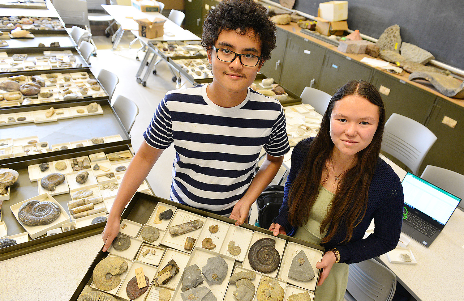 """Sanjirat """"Bright"""" Palakarn '20 and graduate student Melissa McKee '17 are discovering and cataloging thousands of fossils that are owned by Wesleyan.The fossils were once housed at theformer Wesleyan Museum, a natural history museum that occupied part of the Orange Judd Hall of Natural Sciences from 1871-1957. Once the museum closed, the fossils and other objects were displaced at various locations on campus."""