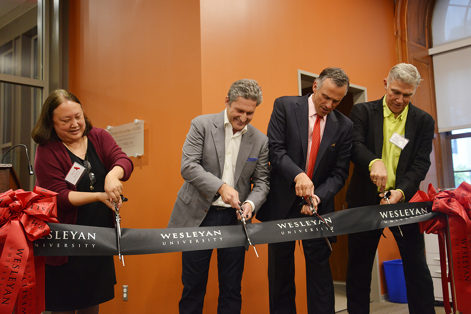 Provost Joyce Jacobsen, Michael Fries '85, Wesleyan President Michael Roth '78 and Professor Antonio Gonzalez participated in a ribbon-cutting ceremony May 25 at the Fries Center for Global Studies.