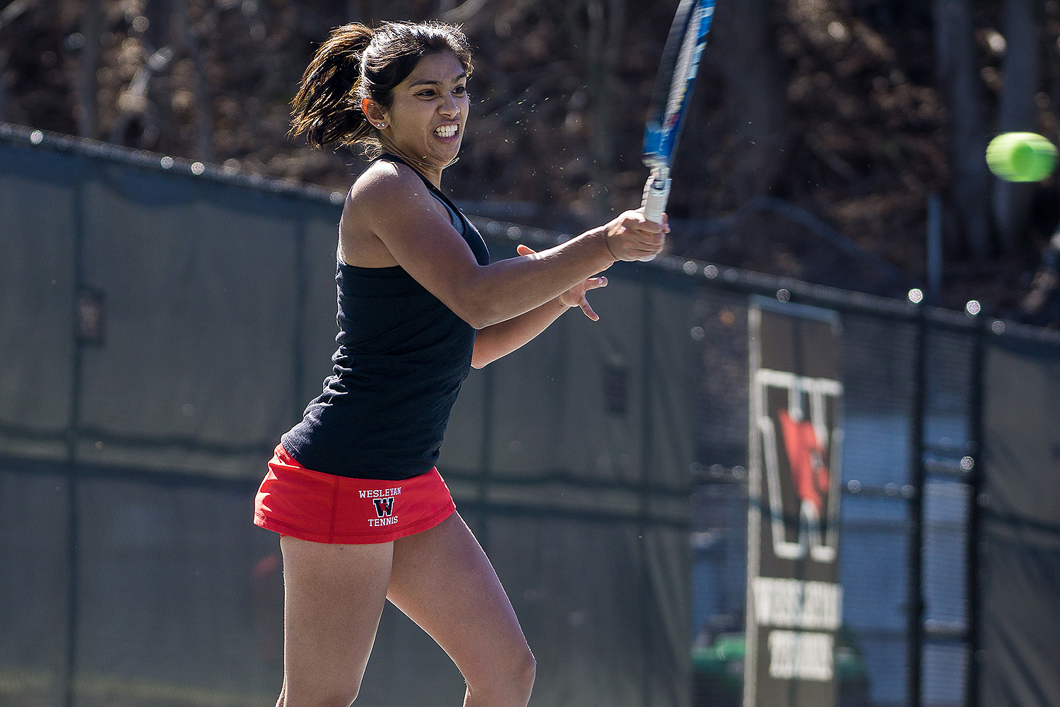 Aashli Budhiraja '18, pictured here playing an opponent from Williams, was one of six women tennis players to be named a Division III Scholar Athlete by the Intercollegiate Tennis Association.