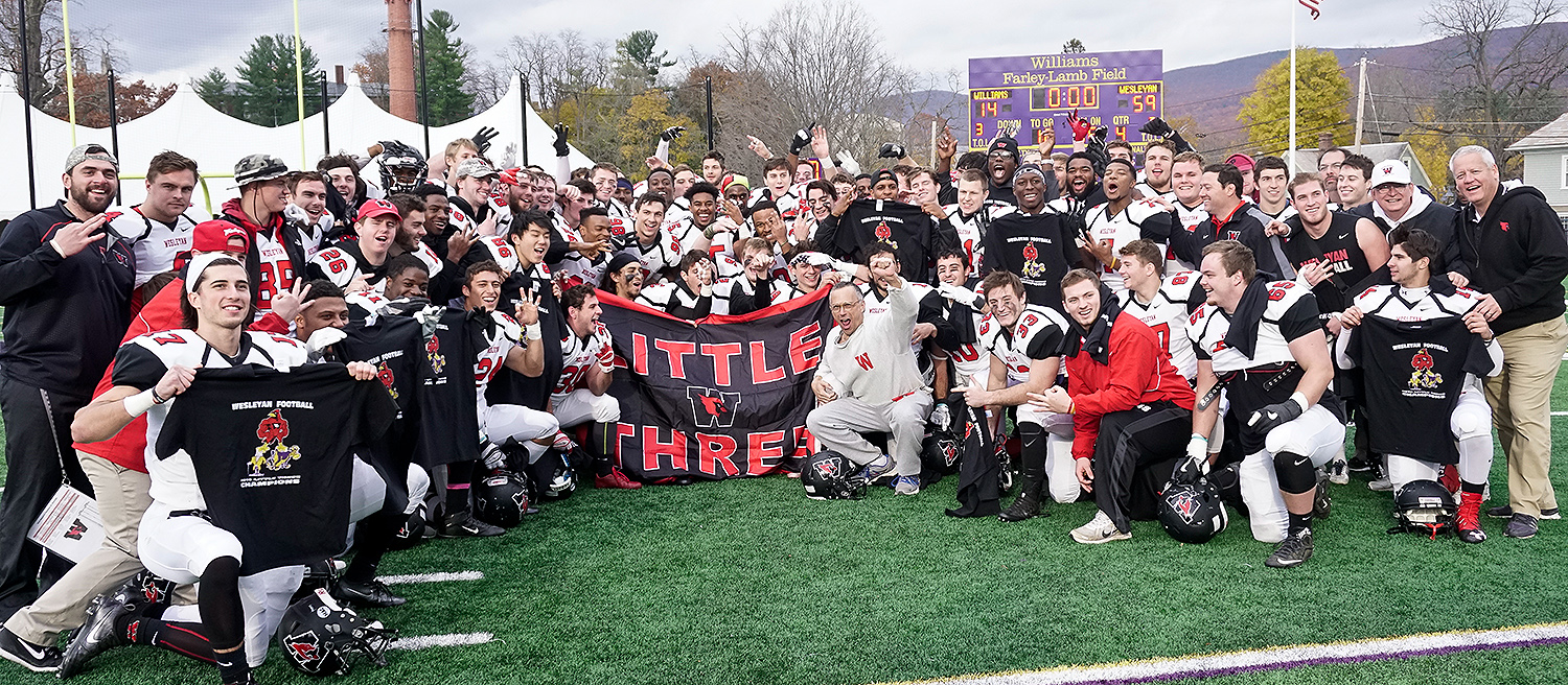 Wesleyan President Michael Roth, center, celebrates the football team's Little Three title at Williams. Wesleyan won 59-14.