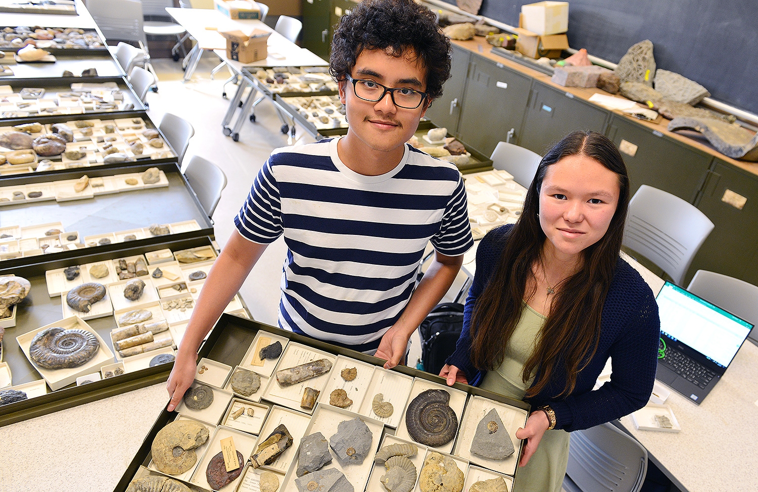 "Research fellows Sajirat ""Bright"" Palakarn '20 and graduate student Melissa McKee '17 are discovering and cataloging thousands of fossils at Exley Science Center. The fossils were once housed at the former Wesleyan Museum, a natural history museum that occupied part of the Orange Judd Hall of Natural Sciences from 1871-1957. Once the museum closed, the fossils and other objects were displaced at various locations on campus. ""We'd love to make these fossils accessible to Wesleyan students, faculty, classes and the general public,"" McKee said. (Photos by Olivia Drake)"