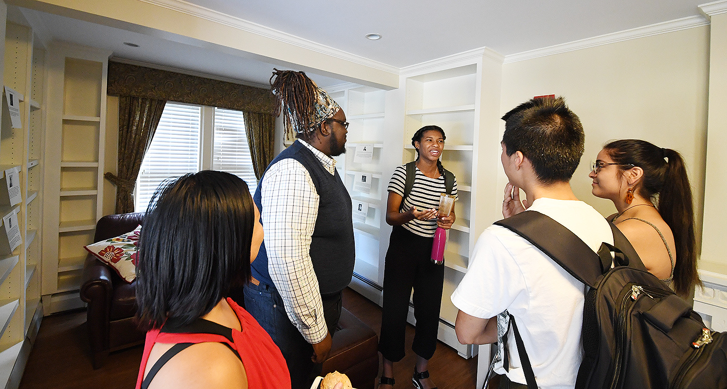 Demetrius Colvin meets with students in the center's future library.