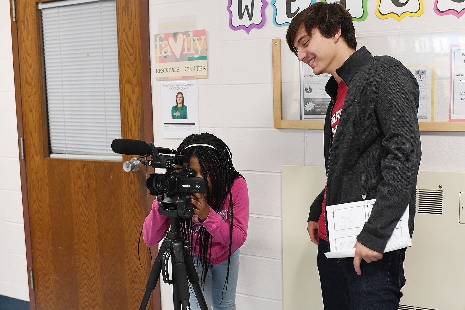 Nick Catrambone '21 works with XXXX on filming a scene for her video.