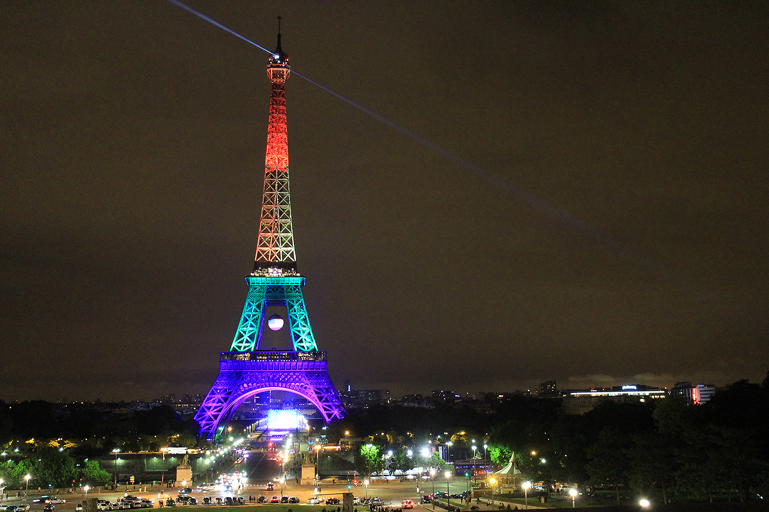 """Love is Love"" by Julie Schwartz, '19 / Paris, France ""I took this picture after the terrorist attacks in Orlando. The Eiffel Tower was lit up with the colors of the Rainbow flag in solidarity with the victims. From where I was standing, the view was breathtaking, and all I could see was how beautiful the tower looked with these colors. Some people around me were singing and lighting candles: they made me feel very hopeful for a better future. When terrible events like the one of Orlando happen, I remember this feeling I had when looking at the tower and I find hope again."""