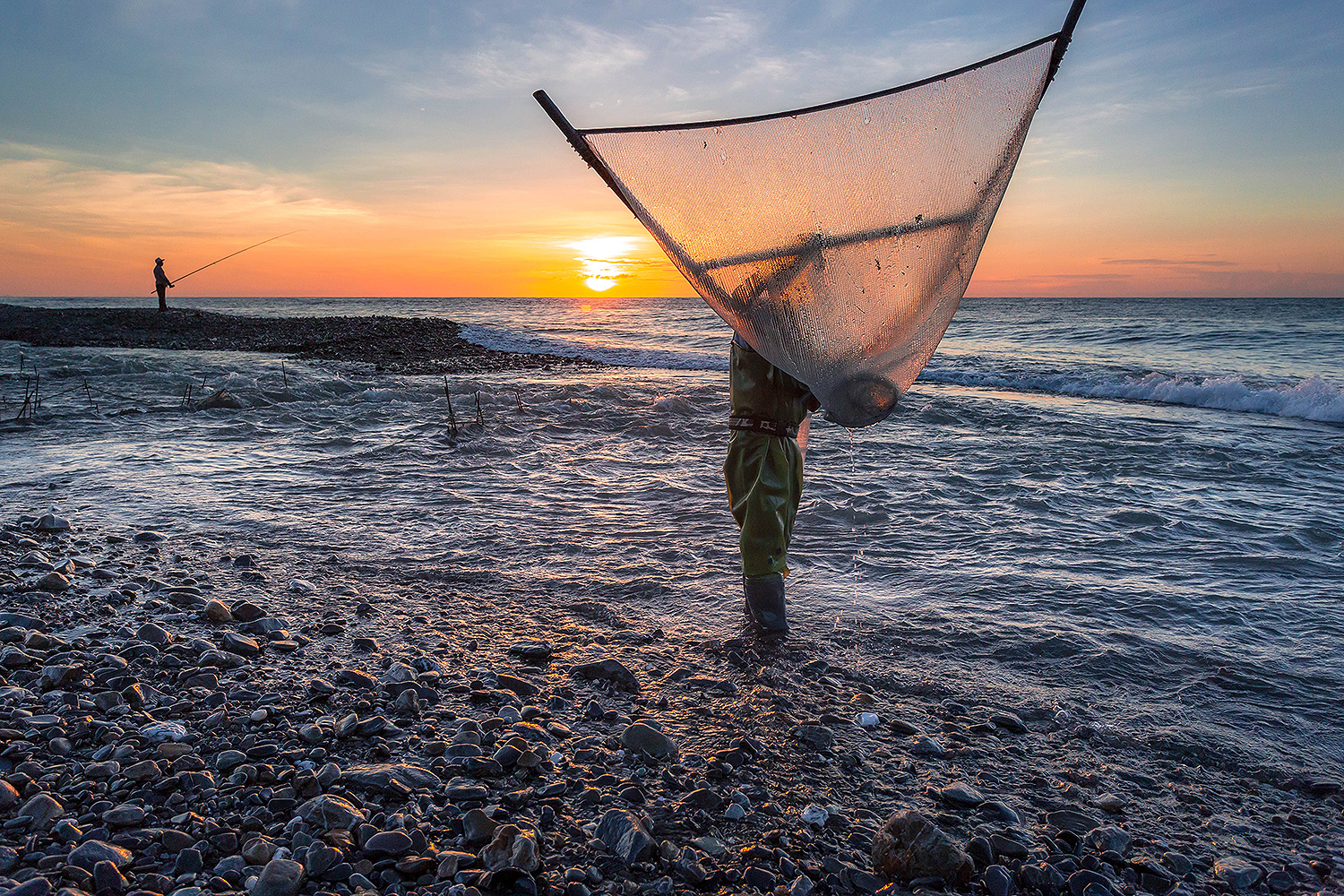 """Fishing at Dawn"" by Brandon Ho, '18 / Jinlun, Taitung, Taiwan ""I was interested in the traditional methods of fishermen using a triangle net to catch fish so I woke up and spent the morning photographing them and learning more about their lives."""