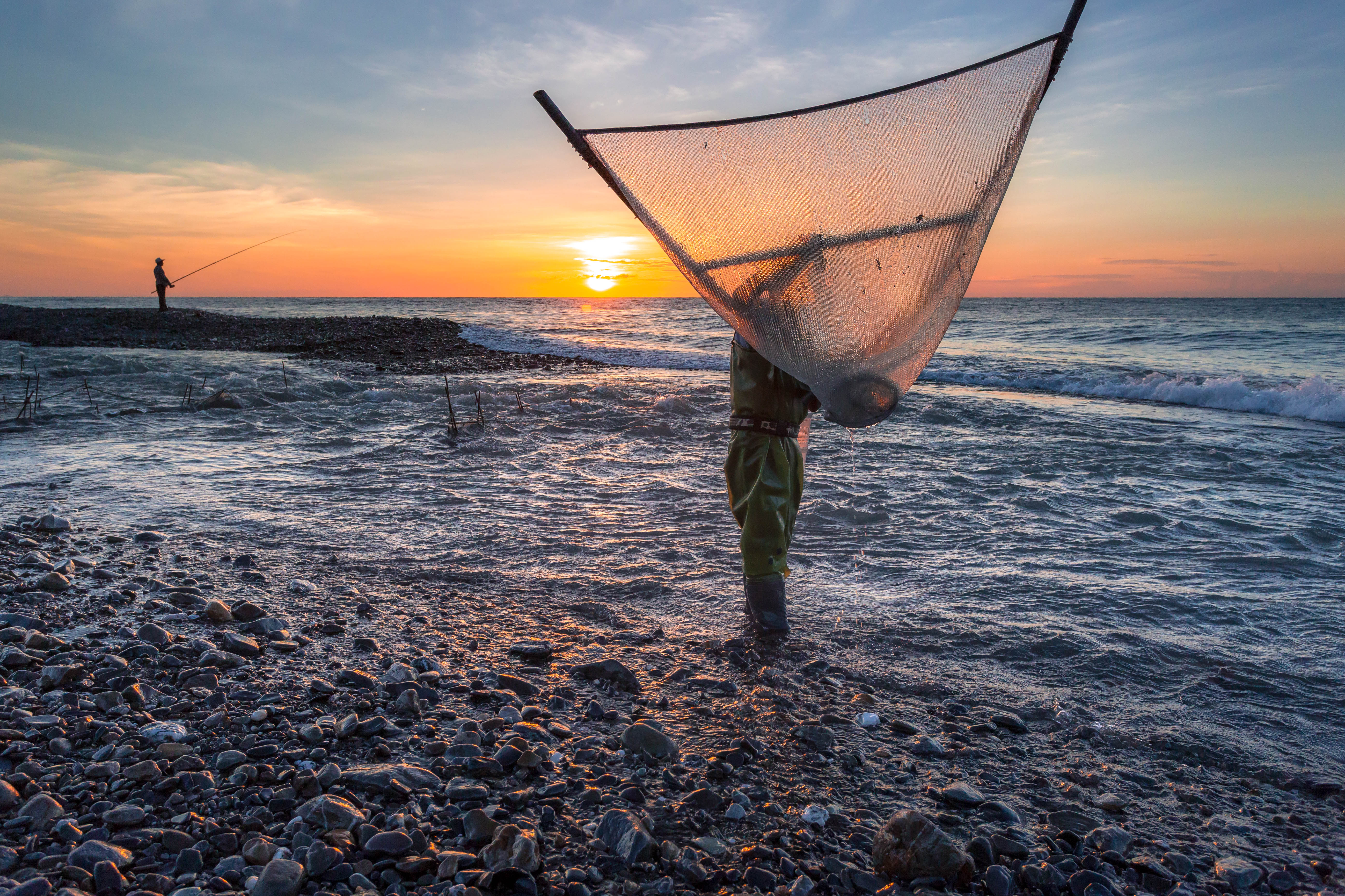 "A photo titled ""Fishing at Dawn,"" by Brandon Ho, '18 won the Best Photo of People category in the Wes in the World Photo Contest."