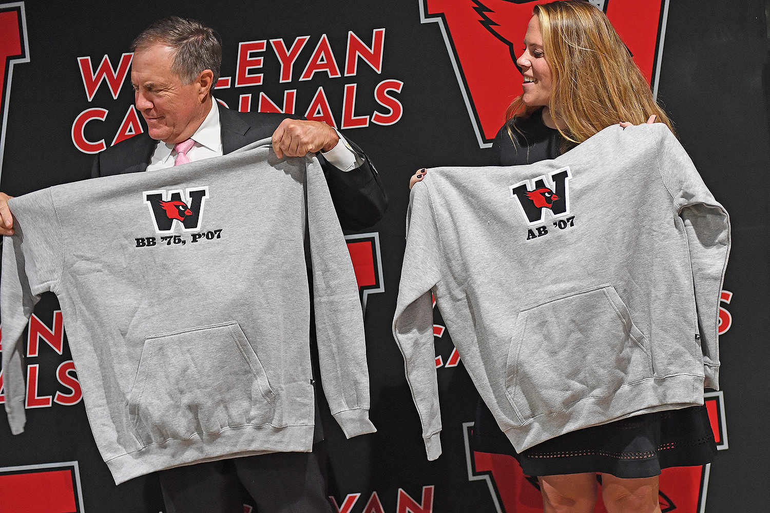 Mike Whalen, the Frank V. Sica Director of Athletics, presented personalized sweatshirts to Bill and Amanda Belichick.