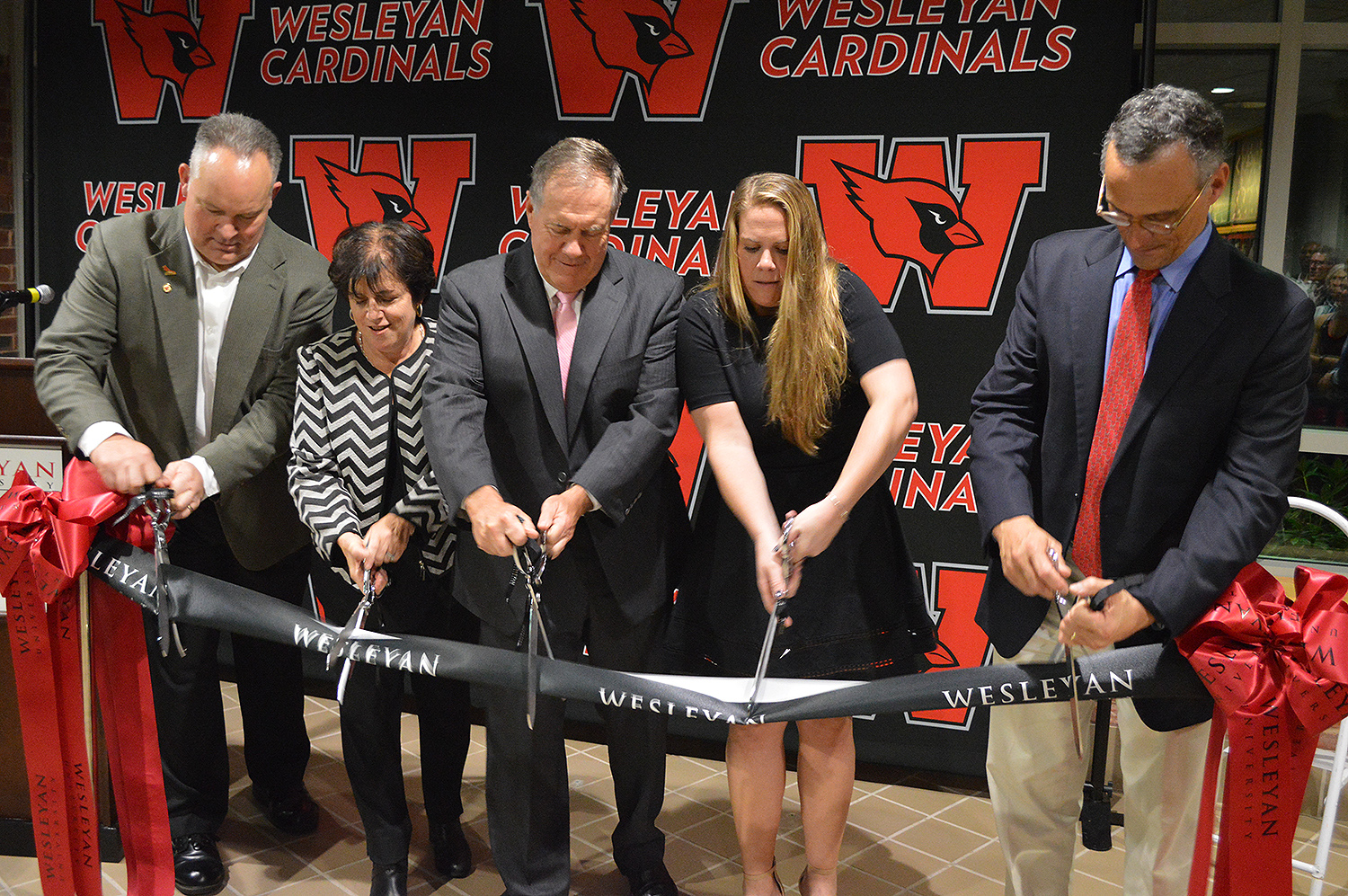 Bill and Amanda Belichick joined Whalen, Morea and Wesleyan President Michael Roth in a ribbon cutting ceremony to officially acknowledge the inside the newly-named Belichick Plaza