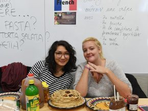 Participants learned how to say phrases in a respective language (Spanish, French, Italian and Arabic) in order to receive the food. Representatives of France served crepes.
