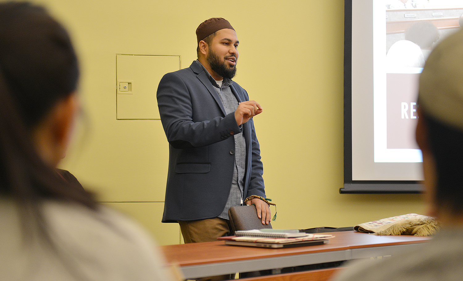 "Chaplain Sami Aziz spoke on ""Islamophobia and Our Denial of It."" He discussed the Anti-Sharia Bill, refugees, and the potential for genocide. Chaplain Aziz has studied various classical Islamic sciences in his studies within the United States and abroad."