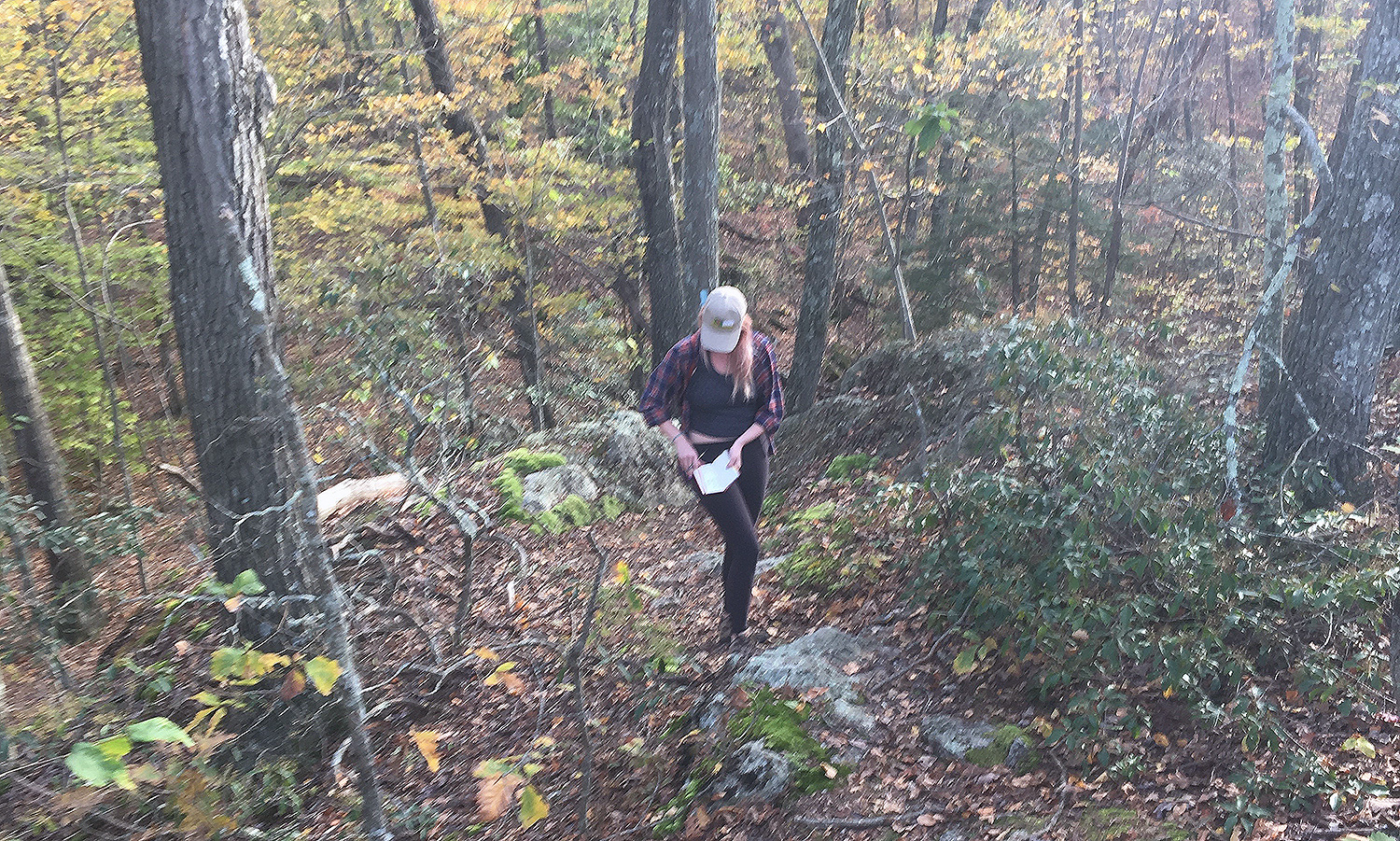 Earth and environmental sciences major Jackie Buskop '19 collects field data along a hiking trail in Connecticut. (Photo by Melissa Luna)
